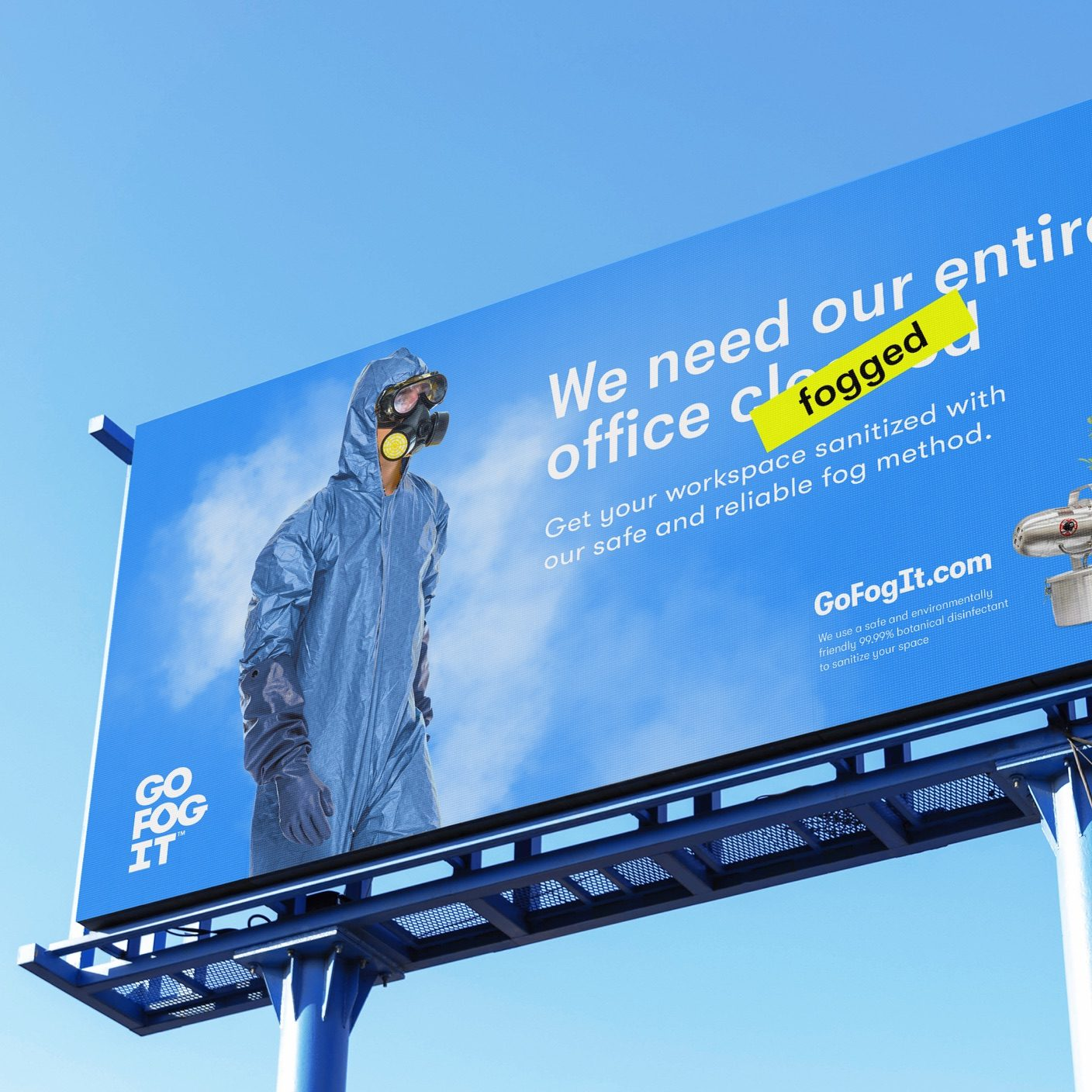 Go Fog It Billboard with a blue sky background, that has a person in a hazmat suit